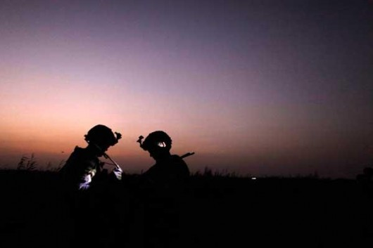 U.S. soldiers at sunset in Iraq