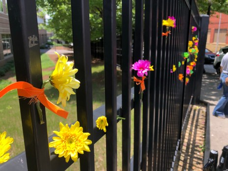 Fence covered with colorful flowers