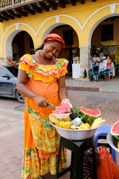 The fruit ladies are famous! At over ten dollars for a bowl of fruit, they smile all the way to the bank.