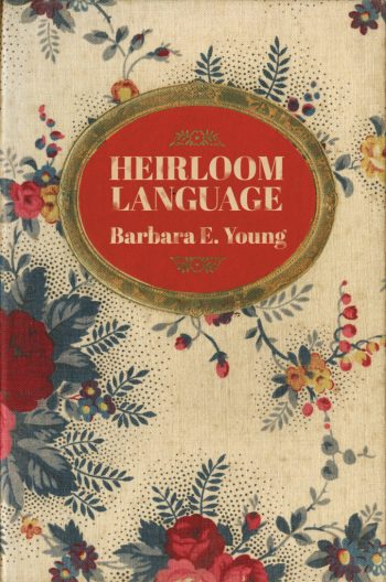 Heirloom Language by Barbara E. Young Front Cover. The text is a serif font, weathered to look like an old book. The font sits inside of a red oval with a gold frame. The circle is over top a vintage floral pattern. Everything is styled to make the cover look like an old heirloom book.