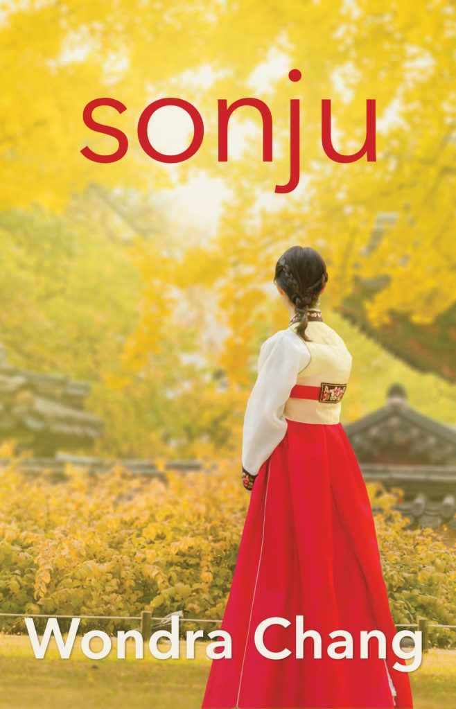 "Sonju by Wondra Chang cover. A woman in a red and white hanbok faces away from the camera towards an old confucian temple and yellow ginko trees. ""Sonju"" is written in a sans-serif font in bright red at the top of the image. Wondra Chang is written in the same font in white at the bottom of the page."