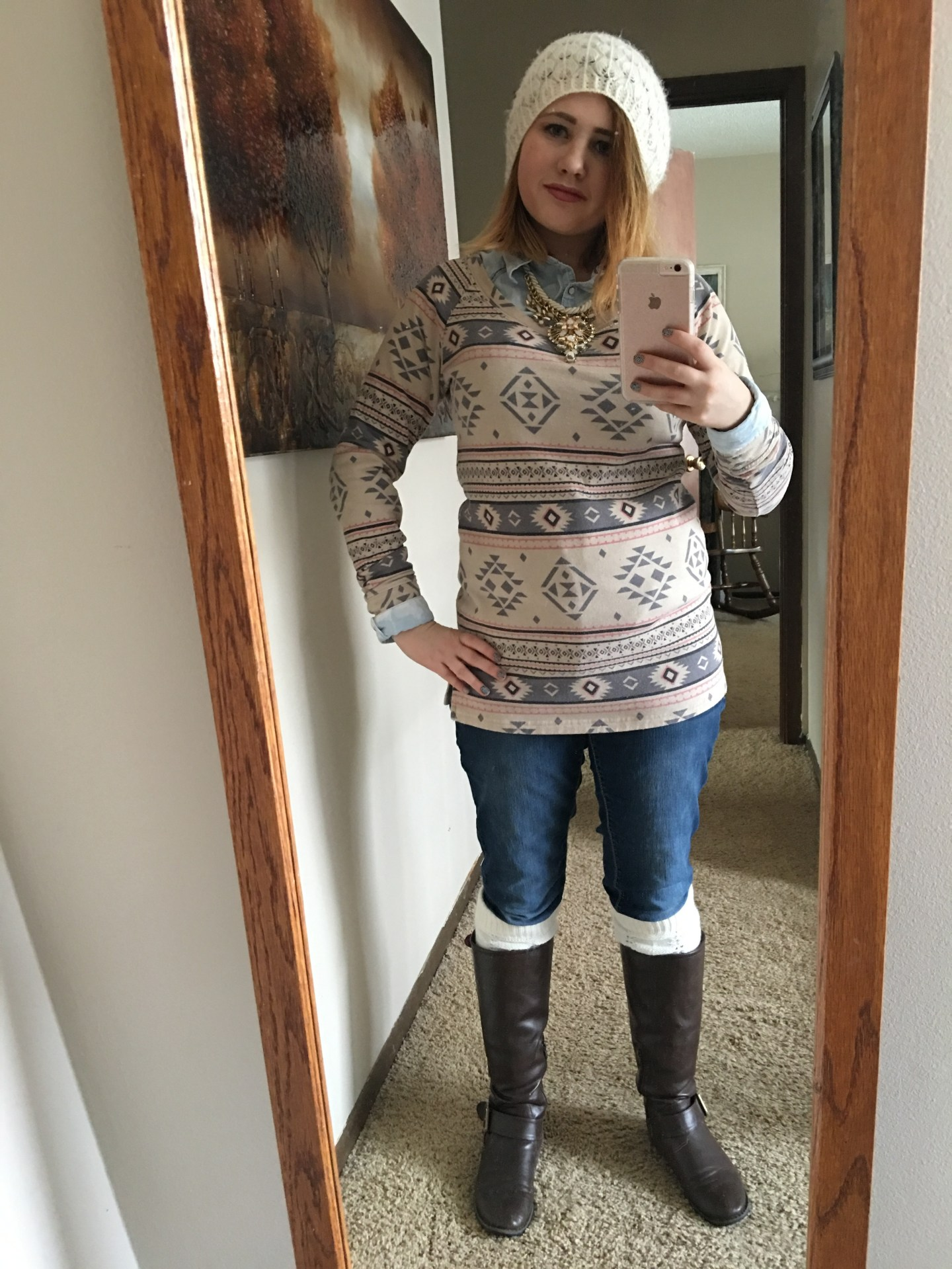 White beanie from Wet Seal, Aztec sweater from Maurices, leg warmers, brown boots from DSW, button up shirt from Maurices, necklace from Target, and jeans from Maurices.