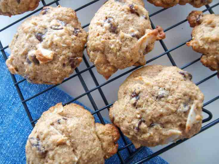 Coconut Quinoa Chocolate Chip Cookies on a black cooling rack.