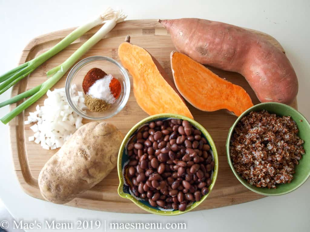Ingredients for vegan sweet potato hashbrown burgers: sweet potatoes, russet potatoes, beans, quinoa, and spices
