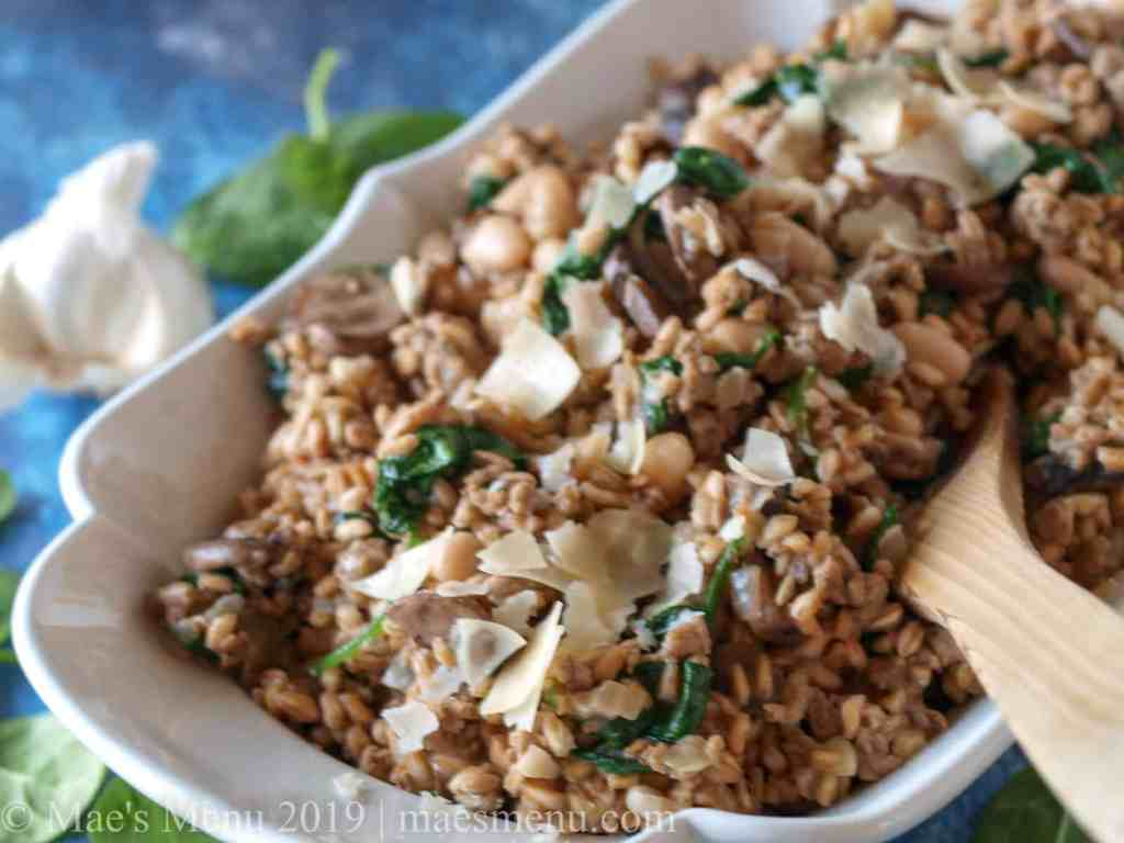 Farro risotto with mushrooms in a large serving bowl.