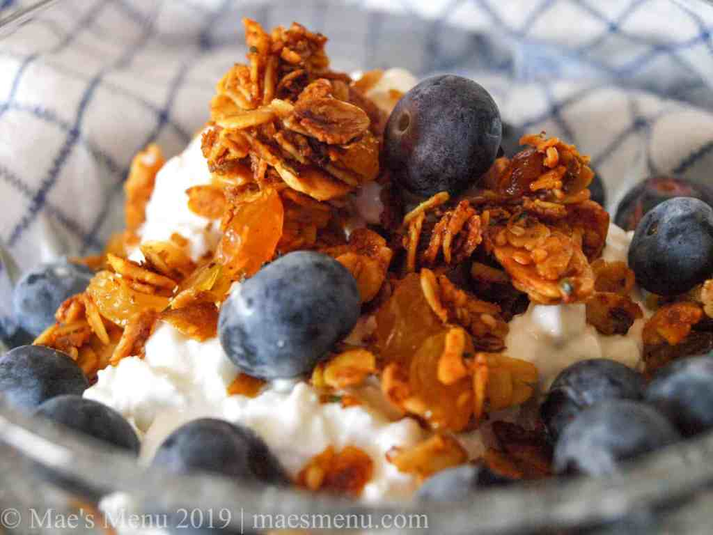 Crunchy turmeric granola and blueberries on cottage cheese.
