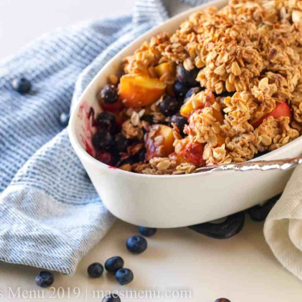Healthy Blueberry Peach Crumble in a white baking dish.