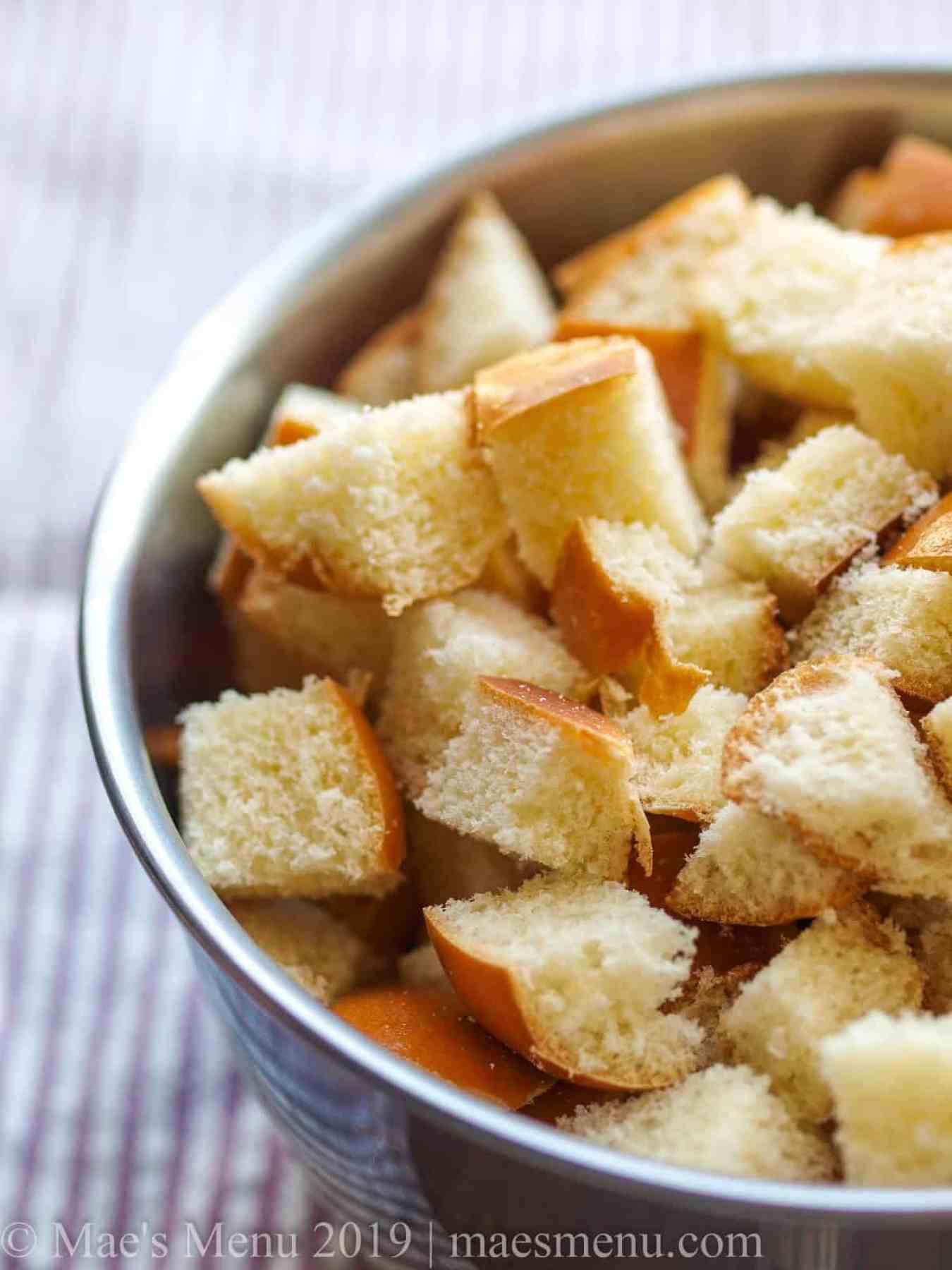 Up-close shot of bread cubes for savory bread pudding.