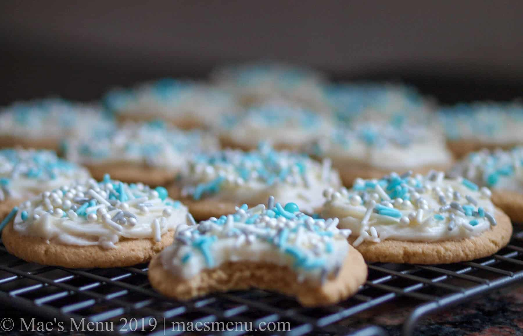 A tray of cooking sugar cookies with vanilla cream cheese frosting.