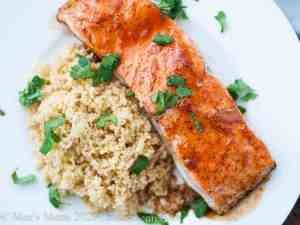 A fillet of spicy bourbon glazed salmon over couscous.