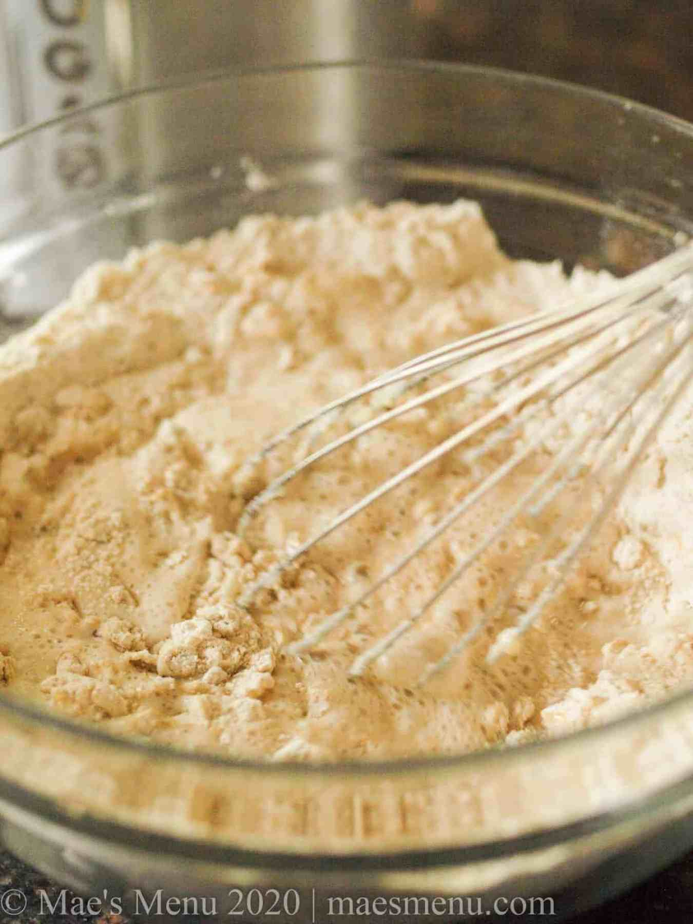 Mixing up the dough for quick oatmeal bread.