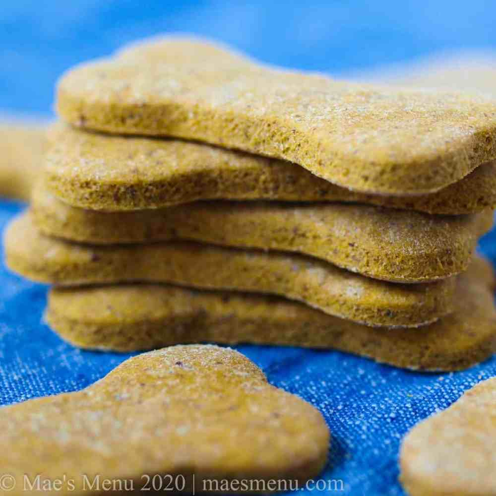 A stack of peanut butter pumpkin dog treats.