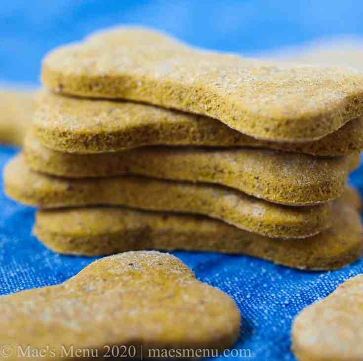 A stack of peanut butter pumpkin dog treats.