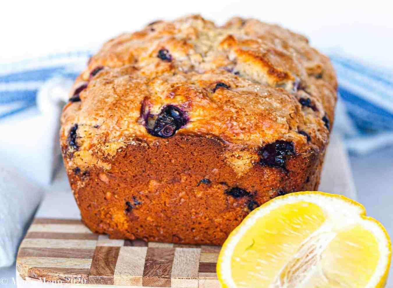 A side shot of a loaf of lemon blueberry bread.