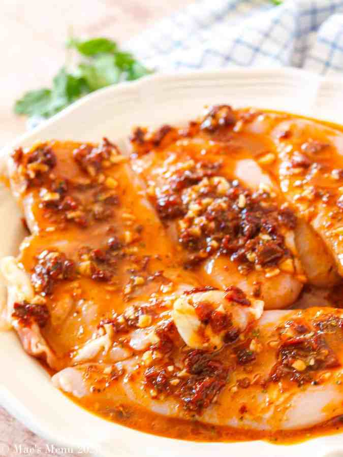 A large white platter of chicken with Mexican Chicken Marinade