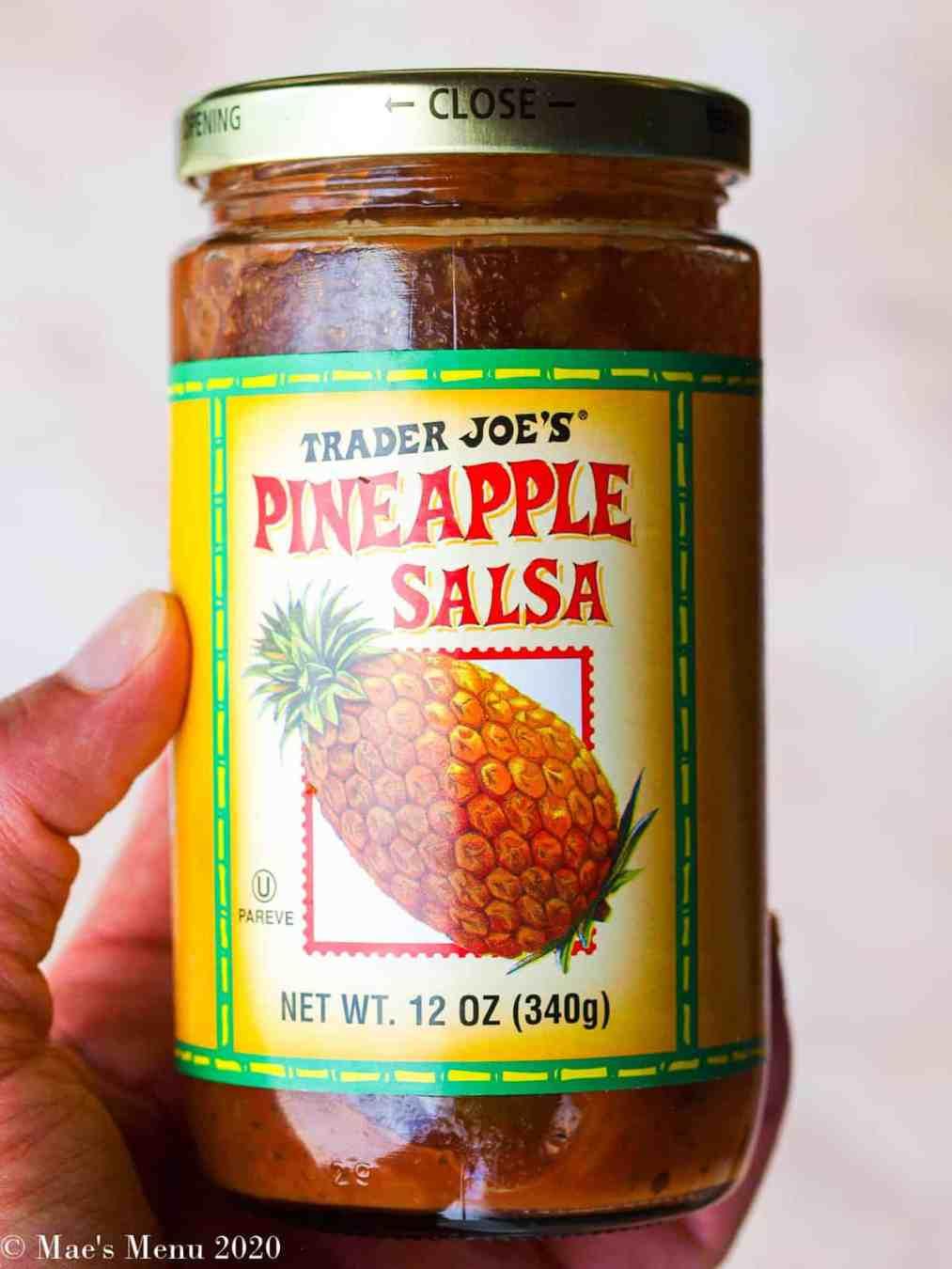 An up-close shot of a bottle of pineapple salsa.