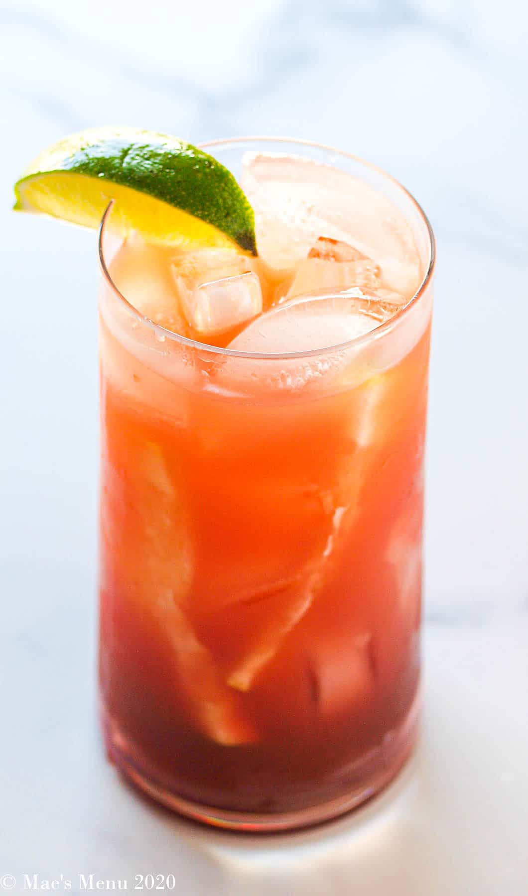 An up-close length-wise shot of a glass of pomegranate sea breeze