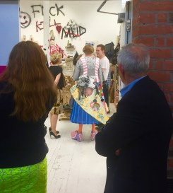 Artist Grayson Perry (left centre) visits MA Fine Art Summer Show at Chelsea College of Arts, London. (right centre) Chris Bagnall. Photo credit Kelise Franclemont.