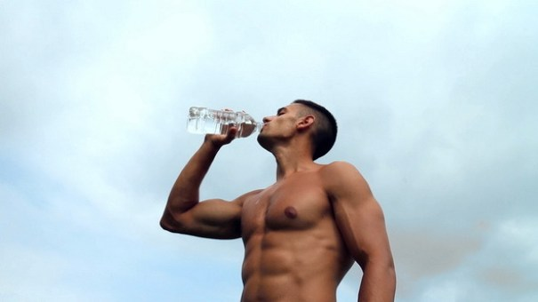 man-with-abs-drinking-water