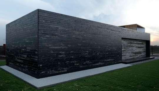 Проект деревянного минималистского дома с плоской крышей