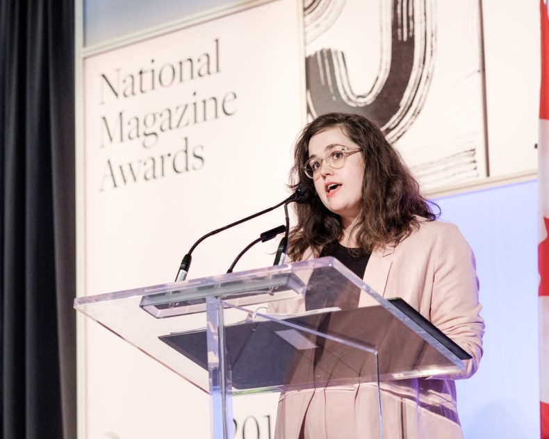 Emily M. Keeler, NMA judge and founding editor of Little Brother Magazine, presents the award for Humour
