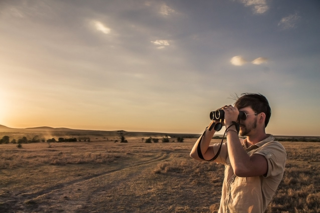 Surveying the open plains through binoculars © Ol Pejeta Safari Cottages