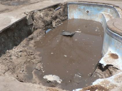 Damaged swimming pool. Water for Elephants Trust, Botswana