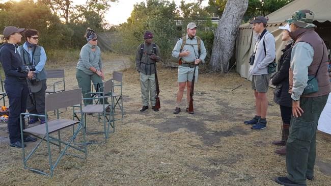 Team chat before bush walk in Tanda Tula
