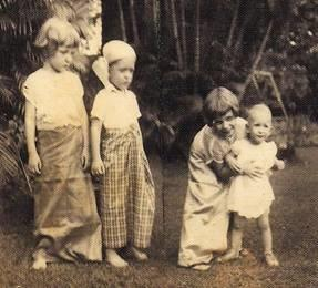 Paula (left) and younger siblings.
