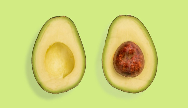 avocado on green background.