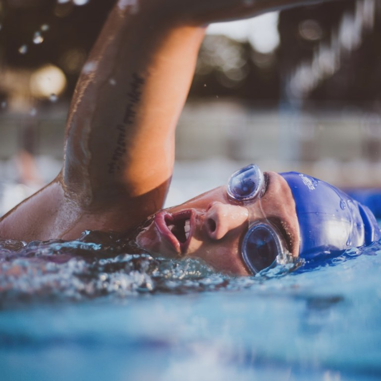Swimmer with blue cap and goggles.