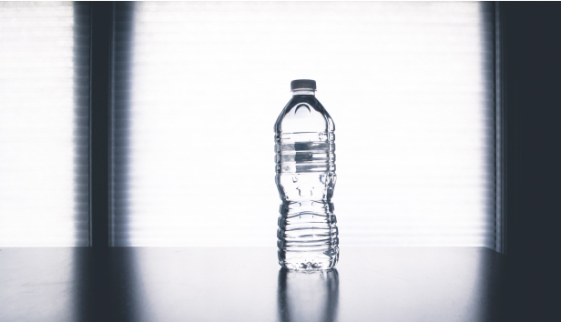 Bottle of water on a table.