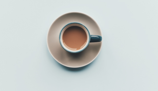Coffee cup on pastel background.