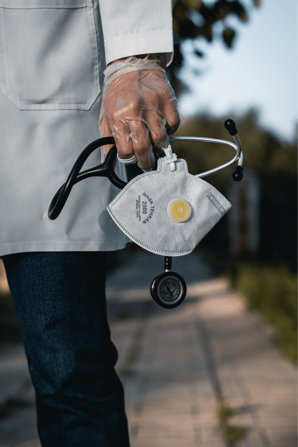 doctor holding stethoscope and mask