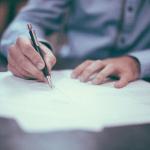 Business Credit report man writing
