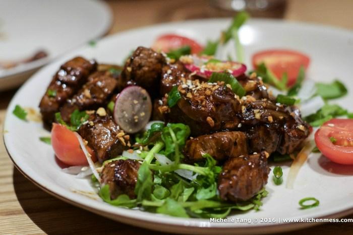 Beef tenderloin, tomato, garlic, and sliced baguette