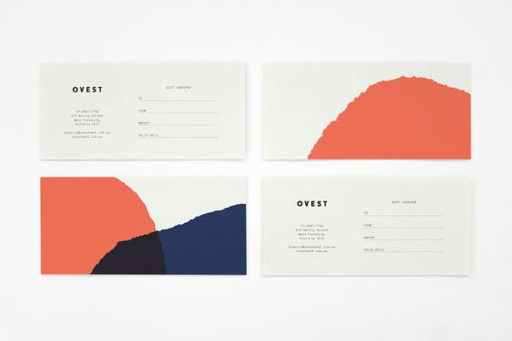 business cards in living coral and navy