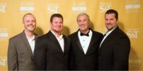 Honoree Roy Wilkens, EE'66 (second from right) poses with Dale Hubbard (left), Eric Wilkens (second from left) and Todd Wilkens (right).