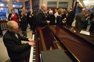 A pianist entertains guests in the Kathleen and Matteo Coco Great Room.