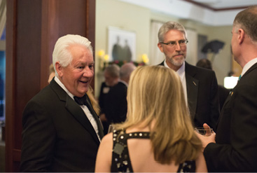 Honoree Bob Brinkmann, CE'71, visits with Jeff Schrader and Dan and Sarah Oerther.