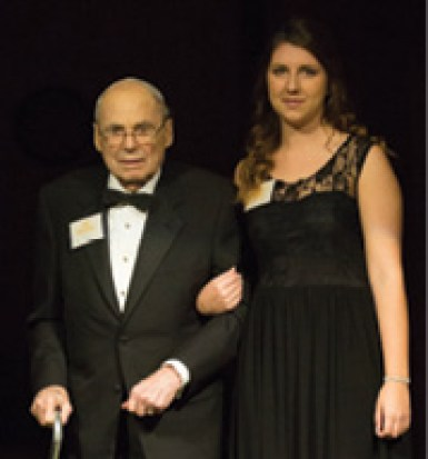 Alyssa Snider, a senior in petroleum engineering, escorts honoree Bob Brackbill, MinE'42.