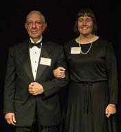 Elizabeth Bowles, a Ph.D. candidate in chemistry, escorts honoree Dick Vitek, MS Chem'58.