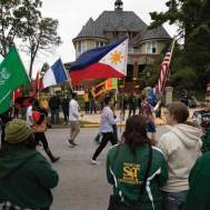 Students marched with flags from around the world during the Homecoming parade.