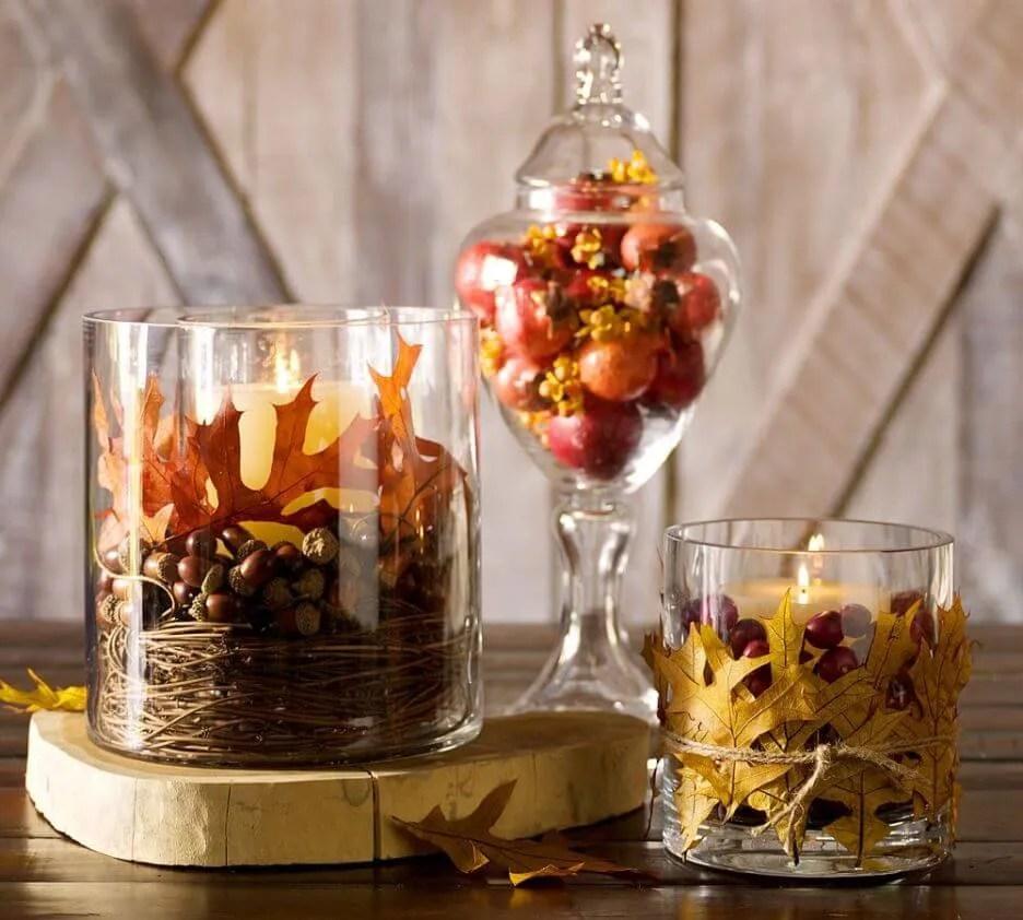 tavola autunnale - candele in vasi di vetro