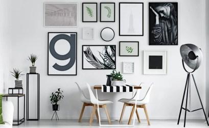 Come appendere quadri e fotografie per arredare una parete