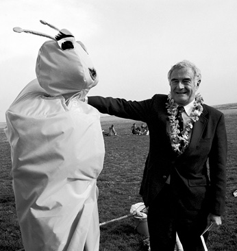 student in Banana Slug costume with Chancellor Robert Sinsheimer at the Banana Slug Spring Fair, May 1986, on the East Field