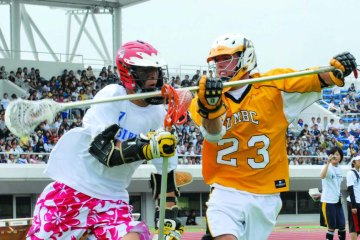 two lacrosse players go head to head Umbc lacrosse players lacrosse stick in front of other player