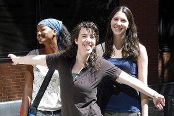 Three girls pose together