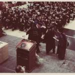 1976 administrators on stage at graduation commencement