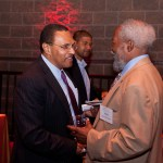 Hrabowski smiles as he talks with man at Hilltop Society event
